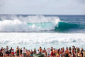 Big waves people watching surfing in the billabong pipeline masters surf contest on the north shore of hawaii part of the triple Stock Photo