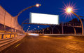 Big white billboard on night highway Royalty Free Stock Photo