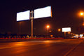Big white billboard on night street Royalty Free Stock Photo