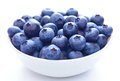Big white bowl full of ripe blueberries on the white background Stock Images