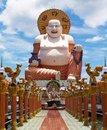 Big white buddha on the blue sky background Royalty Free Stock Photos
