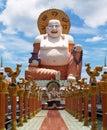 Big white buddha on the blue sky background Royalty Free Stock Photos