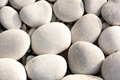 Big white pebble stones on the beach feet massage Stock Image