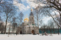 A big white stone church russian cathedral with golden domes Royalty Free Stock Photo