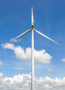 The big and white wind turbine against blue sky background in Th Royalty Free Stock Photo