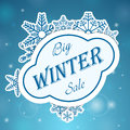Big winter sale on snowflake blue background Royalty Free Stock Photography