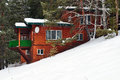 The big wooden house on the mountain in winter time Royalty Free Stock Photos