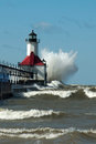 Big WOOSH! wave and michigan lighthouse Royalty Free Stock Photo