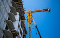 Big yellow building crane near unfinished Royalty Free Stock Image