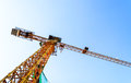 A big yellow crane construction from ant s eye view Stock Image