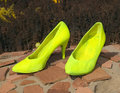 Big yellow female shoes Stock Image
