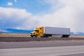 Big yellow rig semi truck trailer on highway in Utah Royalty Free Stock Photo