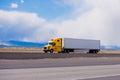 Big yellow rig semi truck trailer on highway in Utah Royalty Free Stock Photo