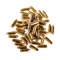Bigger bullet a heap of mm pistol bullets isolated over a white background Royalty Free Stock Photos