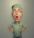 Bighead amazed doctor in glasses funny picture of over dark background Royalty Free Stock Photos