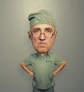 Bighead angry doctor in glasses funny picture of over dark background Stock Image