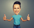 Bighead girl showing thumbs up Royalty Free Stock Photo