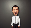Bighead happy man funny picture of in white shirt and tie over dark background Royalty Free Stock Photography