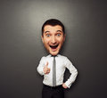 Bighead showing thumbs up happy businessman with big head funny picture over dark background Royalty Free Stock Photo
