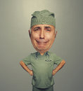 Bighead sorrowful doctor in uniform funny picture of Stock Photography