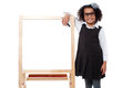 Bight school kid ready to teach classmates cute schoolgirl posing beside blank whiteboard Royalty Free Stock Photos