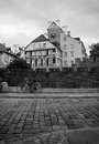 Bike on the block pavements on the background of medieval houses in warsaw black and white Stock Photo