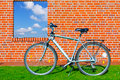 Bike at a brick wall with a window in the sky Royalty Free Stock Photography