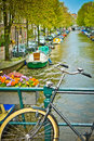Bike bridge flowers canal amsterdam netherlands Royalty Free Stock Image