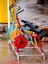 Bike colorful robust metal public exercise bicycle equipment outdoor in sport zone of a vintage boutique resort Stock Photos