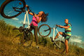 Bike couple sport riding bikes in field Royalty Free Stock Photo