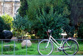 Bike in downtown green area single white parked a rome italy with arch of constantine background Royalty Free Stock Photo