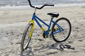 Bike and flip flops at the beach rental a pair of Stock Image