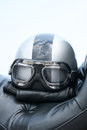 Bike helmet closeup of an with windproof glasses on a cruiser motorcycle seat Stock Photos