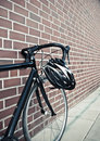 Bike helmet on race road cycle Royalty Free Stock Photo