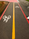Bike Lane signs on street ground Royalty Free Stock Photo