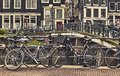 Bike over canal Amsterdam city. Picturesque town landscape in Netherlands. Royalty Free Stock Photo