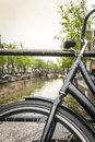 Bike over canal in Amsterdam, The Netherlands Royalty Free Stock Photo