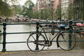 Bike parked on Amsterdam bridge Stock Photography