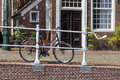 Bike parked on street bicycle against bridge railing old Stock Images