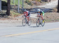 Bike race competitors these two cyclists from the redlands bicycle club are racing in a time trial at big bear lake california Royalty Free Stock Photos