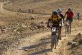 Bike race in desert Royalty Free Stock Photo