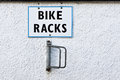 Bike racks a metal rack on a white wall Stock Image