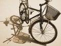 Bike reflect on sand old surface under sunshine day Royalty Free Stock Photography