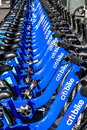 Bike rental in new york city november blue citi bikes lined up near madison square garden at th avenue manhattan on november the Royalty Free Stock Photography