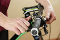 Bike repair. Bicycle fixing. Hex wrench works. Man configures th Royalty Free Stock Photo