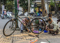 Bike repair business on a corner of the street hanoi vietnam circa march small free enterprise vendor working bicycle Royalty Free Stock Photo