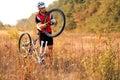 Bike repair. Young man repairing mountain bike Royalty Free Stock Photo