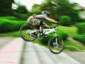 Bike rider at urban downhill competition Royalty Free Stock Photo