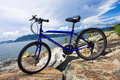 Bike in the sea bay and blue sky Stock Images