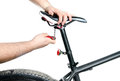 Bike seat adjustment fot rider Stock Images